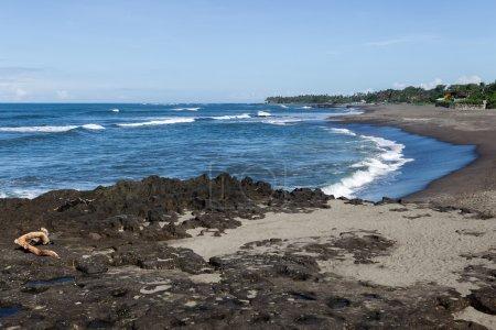 Ocean rocky coast in Bali, sunny weather