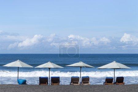 White umbrellas at the ocean coast