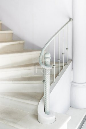 White stairs with vintage white railing