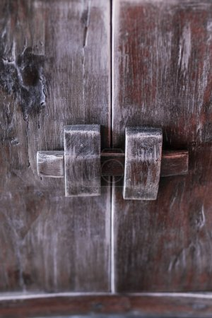 Vintage door knob on wooden antique door furniture