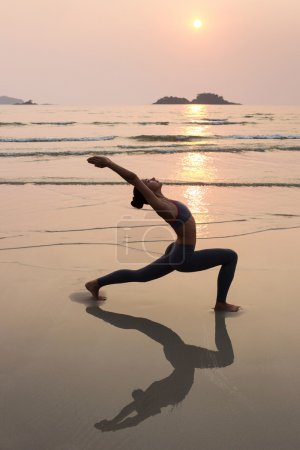 Young slim woman practicing yoga