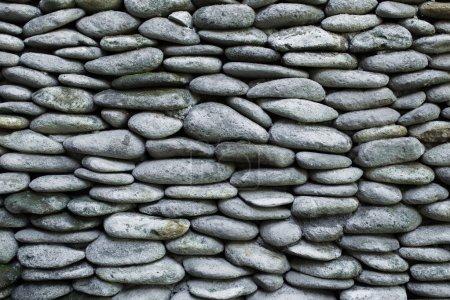 Photo pour Texture de mur de pierre de galets - image libre de droit