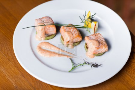 Fried salmon on plate