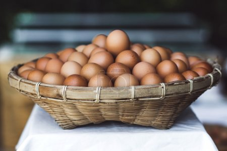 Photo for Wicker basket with fresh eggs - Royalty Free Image