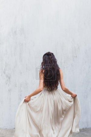 Bride in an elegant silk dress