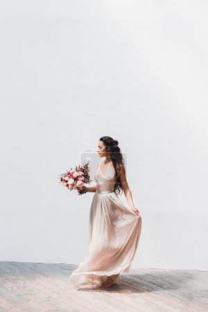 Bride in silk dress with flowers