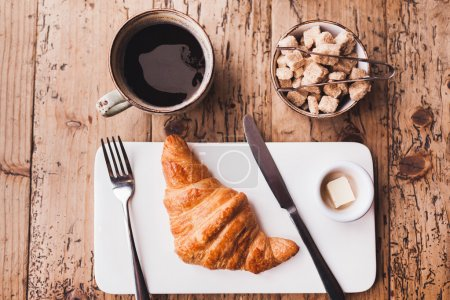 Breakfast with coffee and butter croissant