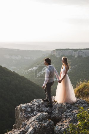 Newlyweds on walk in mountains