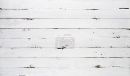 Photo for Distressed white wood texture background viewed from above. The wooden planks are stacked horizontally and have a worn look. This surface would be great as design element for a wall, floor, table etc. - Royalty Free Image