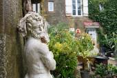Old statue in the yard