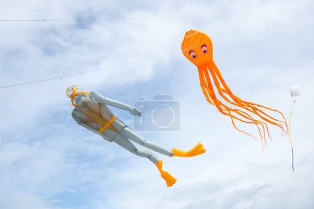 Kites of diver and octopus