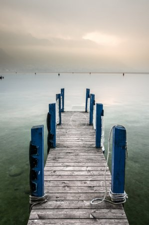 Wooden dock and blue pillar