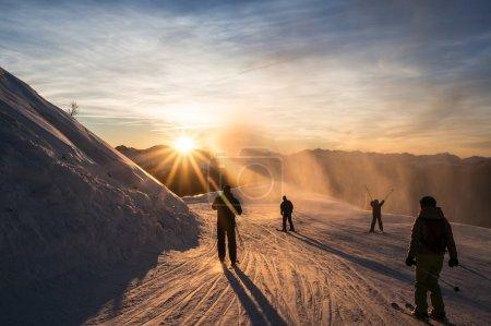 Skiers on the piste at dusk, Les Arcs, Bourg Saint...