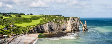 Photo for Picturesque view of seashore near Etretat is best known for its cliffs, including three natural arches and the pointed needle - Royalty Free Image