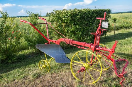 Old colorful French plow