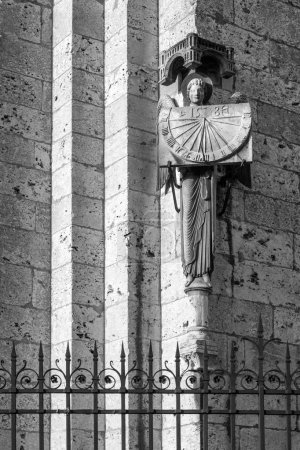 Statue of an angel holding a sundial