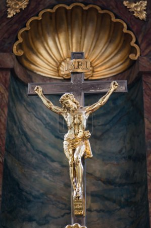 Photo for Golden Statue of Jesus Christ crucified on a cross in a church, Wroclaw, Poland - Royalty Free Image