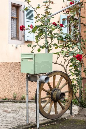 Mailbox with wheel and flowers