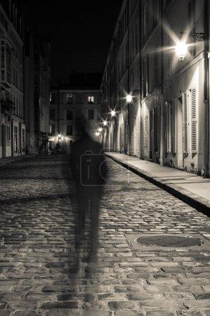 Cobblestone street at night in Paris