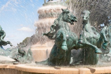 Sculpture of horses in the fountain