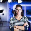 Young beautiful brunette television announcer at s...