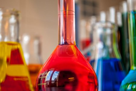 Chemistry overdosed in a red chemical filled vial