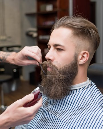 Handsome man with a long mustache in barbershop