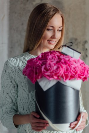 Girl with hat box flowers