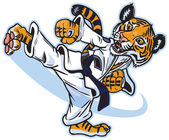 Vector clip art cartoon illustration of a cute young tiger cub martial artist executing a spinning back kick