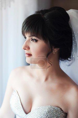 Beautiful bride outdoors - soft focus. Portrait of a beautiful girl