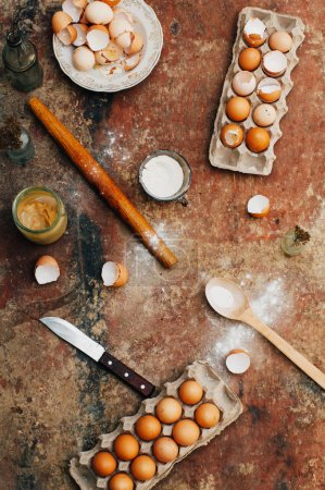 Photo for Baking cake ingredients - bowl, flour, eggs, egg whites foam, eggbeate on wood chalkboard from above. Cooking course or kitchen mess poster concept. Flat lay. Rustic style - Royalty Free Image