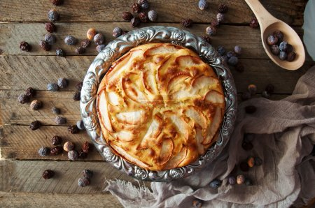 Photo for Homemade organic apple pie dessert ready to eat. Delicious and beautiful apple pie on a wooden table, on a rustic wood kitchen table, horizontal format. Pie on breakfast, blueberries, food, pie - Royalty Free Image