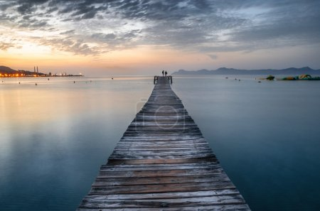 Photo for Majorca Puerto de Alcudia beach pier at sunrise in Alcudia bay in Mallorca Balearic islands of Spain - Royalty Free Image