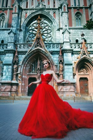 Beautiful girl in long red dress and in royal