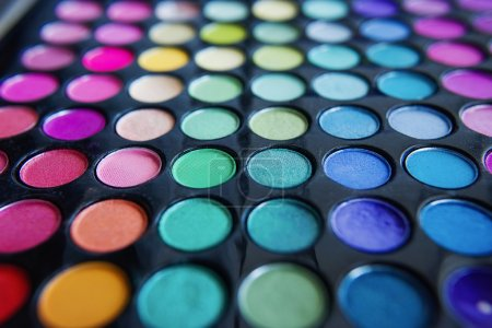 Palette of colorful eye shadows and make up brush