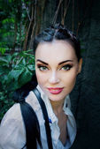 Portrait of a dark hair girl in the Lara Croft's style