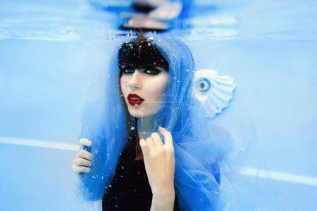 woman underwater in the swimming pool