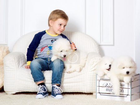 boy with white puppies