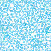 Winter pattern with variety of snowflakes on a light background