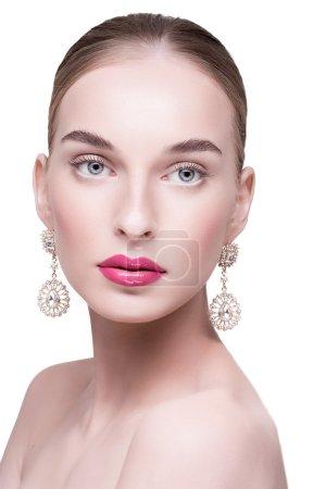 beautiful beautiful white woman with earrings