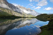 Lake and mountain range in Swiss alps