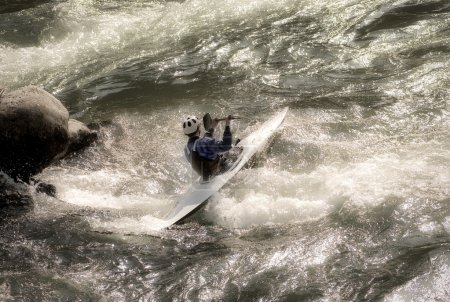 Canoeist in the rapids of the river