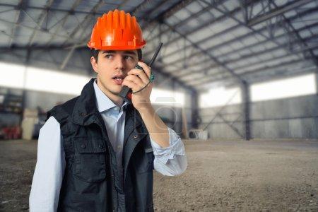 young engineer in helmet