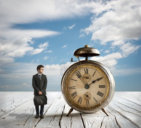 man and old table clock