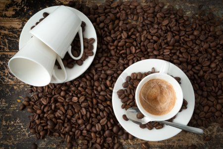 Photo for Cup of coffee with coffee beans - Royalty Free Image