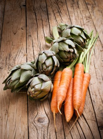 Fresh carrots and artichokes