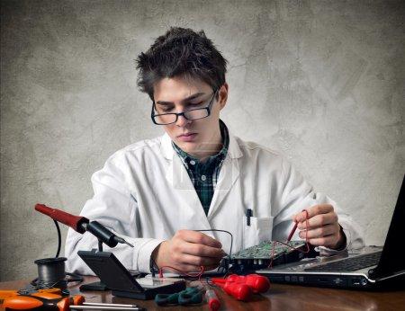 Young electronic technician