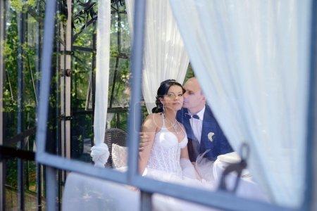 Wedding couple near decorated table