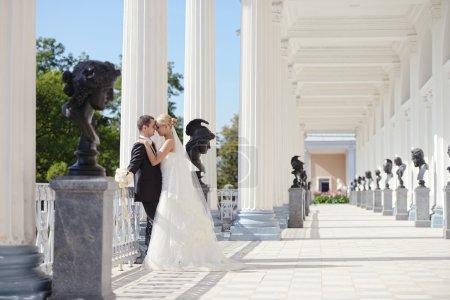 Wedding couple hugging on terrace