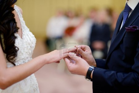 Photo for Beauty bride and handsome groom wearing rings each other. Wedding couple on the marriage ceremony. Female and male portrait. Cute lady and guy - Royalty Free Image